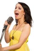 Singing woman isolated on white — Stock Photo