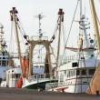Fisher trawlers in harbor - Stock Photo