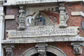 Historic plaque in dutch facade — Stock Photo