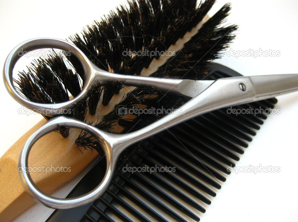 A brush, comb and a pair of hairdressers scissors  Stock Photo #3157216