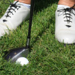Womens golf shoes and golfball — Stock Photo