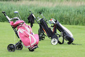 Golfbags on the green — Stock Photo