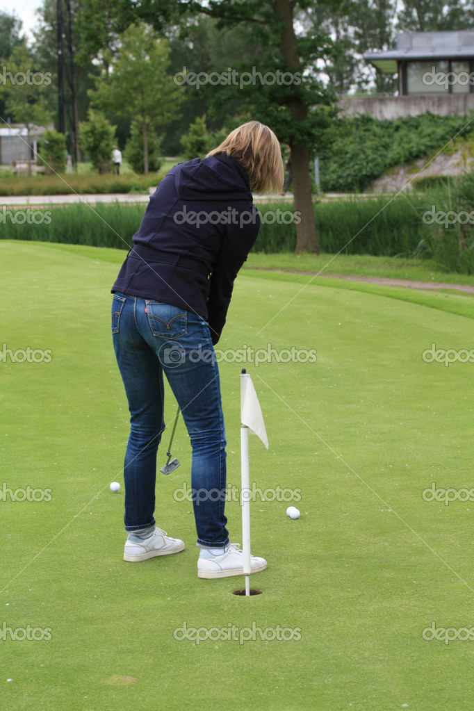A woman practising golf on the chipping green — Stock Photo #3309270