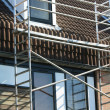 Scaffolding on a town house - Stock Photo