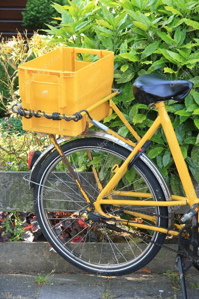 Yellow bike with a container, used to transport the daily mail and small packages  Stock Photo #3495110