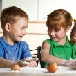 Little assistants on kitchen — Stock Photo