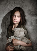 Sad little girl with toy — Stock Photo