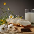 Bread, milk and wild flowers — Stock Photo