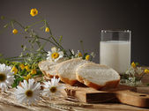 Bread, milk and wild flowers — Stok fotoğraf