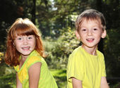 Happy children in forest — Stock Photo