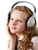 Pensive teenage girl with headphones — Stock Photo
