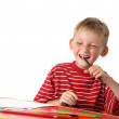Laughing little boy with colored pencils — Stock Photo #3578850