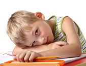 Tired little schoolboy — Stock Photo