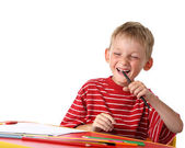 Laughing little boy with colored pencils — Stock Photo
