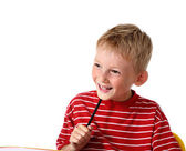 Happy little boy with pencil — Stock Photo