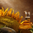 Oil bottle with sunflowers — Stock Photo