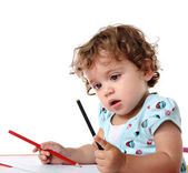 Little girl with colored pencils — Stockfoto
