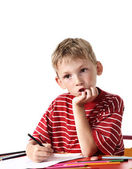 Boy with colored pencils — Stock Photo