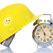 Stock Photo: Alarm clock and helmet