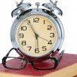 Book with alarm clock and eyeglasses — Stock Photo