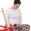 Pregnant woman and toys — Stock Photo