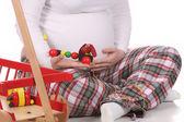 Kobiety w ciąży i zabawki — Zdjęcie stockowe