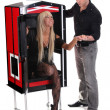 Stock Photo: Magician performance with beauty girls in a magic box