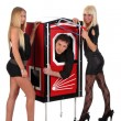 Stockfoto: Magician performance and two beauty girls in a magic box with ha
