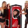 Magician performance and two beauty girls in a magic box with ha — Stock Photo