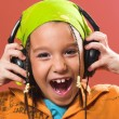 Child listening music in headphones — Stock Photo
