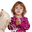 Little girl with cream - Stock Photo