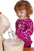 Little girl with mixer — Stock Photo