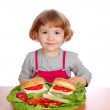 Little girl with sandwiches and vegetabl — Stock Photo