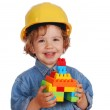 Little girl builder with toy block house — Stock Photo