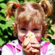 Stock Photo: Little girl with chicken