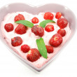 Strawberries in heart shape plate — Stock Photo