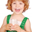 Happy little girl with glass of milk — Stock Photo