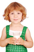 Beauty little girl with glass of milk — Stock Photo