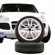 Car aluminum wheel and 4x4 suv isolated on white - Stock Photo