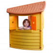 Little girl in playhouse toy isolated — Stock Photo