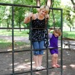 Mother and daughter fun in park playground — Stock Photo