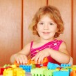 Little girl play with toy blocks — Stock Photo