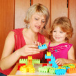 Mother and daughter playing with toy blocks — Stock Photo