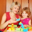 Stock Photo: Mother and daughter playing with toy blocks