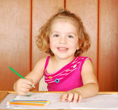 Happy little girl drawing — Stock Photo