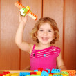 Little girl fun with toy block — Stock Photo