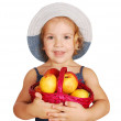 Little girl holding basket with peaches — Stock Photo