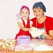 Mother and daughter make croissants — Stock Photo