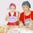 Stock Photo: Mother and daughter make rolls