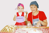 Mother and daughter make rolls — Stock Photo